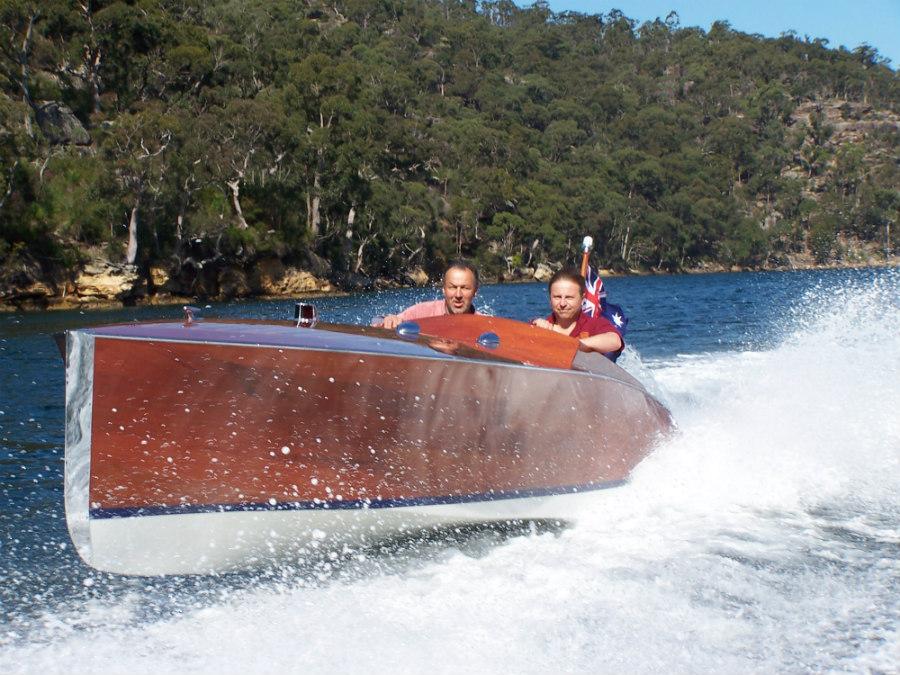 James Frecheville in classic wooden speedboat